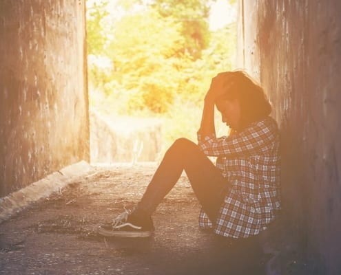 Coping With Teenagers - Young Dark Skinned Girl In Tunnel With Depression and Anxiety. Counselling Melbourne.