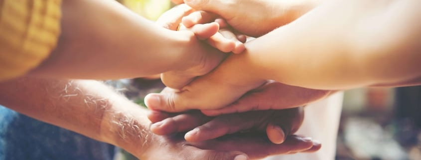 Mental Ask For Support Min - Group of people showing support and holding hands.
