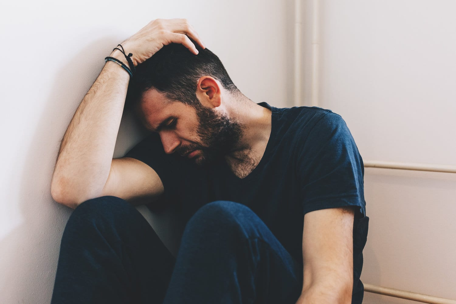 Divorce And Separation Counselling Melbourne - Sad young man sitting in the corner of the room